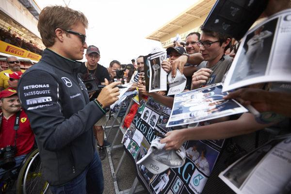 Circuit de Catalunya, Barcelona, Spain. Thursday 8 May 2014. Nico Rosberg, Mercedes AMG, signs autographs for fans. World Copyright: Steve EtheringtonLAT Photographic. ref: Digital Image SNE11646 copy