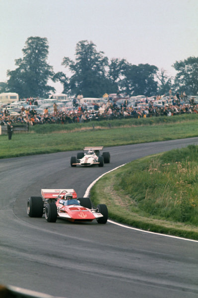 1970 International Gold Cup.  Oulton Park, Cheshire, England. 22nd August 1970.  John Surtees, Surtees TS7 Ford, leads Jackie Oliver, BRM P153.  Ref: 70GC14. World Copyright: LAT Photographic