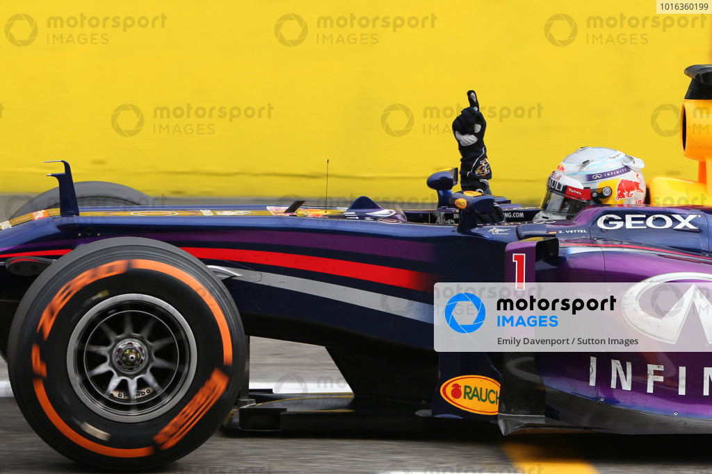 Sebastian Vettel (GER) Red Bull Racing RB9 crosses the line to win his third Italian Grand Prix. Formula One World Championship, Rd12, Italian Grand Prix, Race, Monza, Italy, Sunday 8 September 2013.  BEST IMAGE
