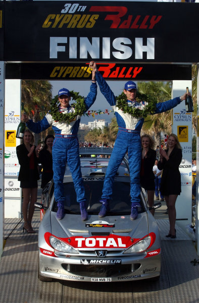 World Rally Championship, Cyprus Rally, April 18-21, 2002.Marcus Gronholm (R) and Timo Rautiainen (L) celebrate victory on the podium.Photo: Ralph Hardwick/LAT