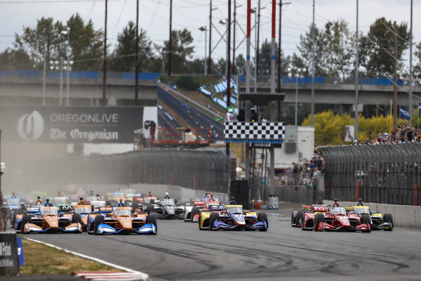 #10: Alex Palou, Chip Ganassi Racing Honda, #9: Scott Dixon, Chip Ganassi Racing Honda lead at the start