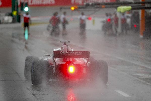 Marcus Ericsson, Sauber C37 Ferrari, leaves the pit lane with his rain light on.