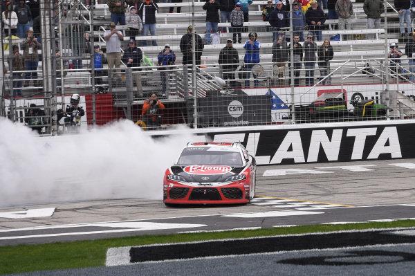 #20: Christopher Bell, Joe Gibbs Racing, Toyota Supra Rheem, does a burnout after winning.