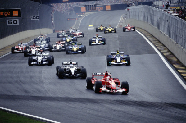 Rubens Barrichello, Ferrari F2004 leads Kimi Räikkönen, McLaren MP4-19B Mercedes and Felipe Massa, Sauber C23 Petronas at the start.