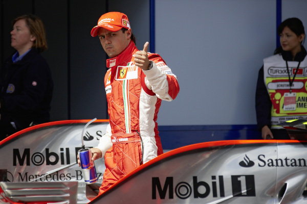 Pole sitter Felipe Massa gives a thumbs up in parc ferme.