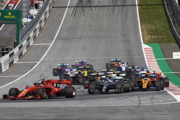 Charles Leclerc, Ferrari SF90, leads Valtteri Bottas, Mercedes AMG W10, Lewis Hamilton, Mercedes AMG F1 W10, Lando Norris, McLaren MCL34, Kimi Raikkonen, Alfa Romeo Racing C38, and the rest of the field at the start