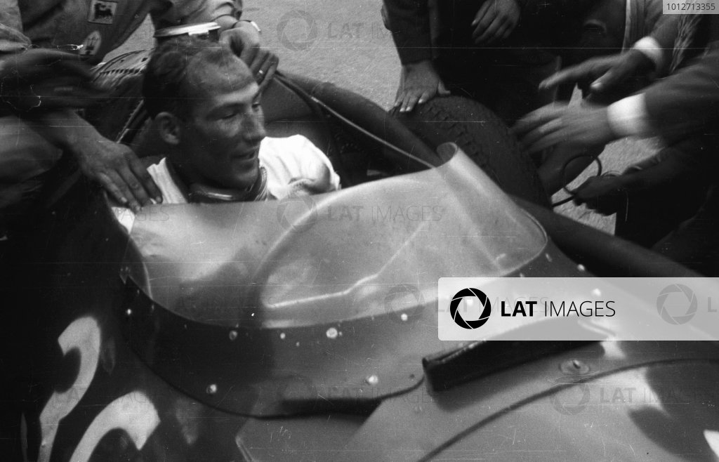 1956 Italian Grand Prix.Monza, Italy.31/8-2/9 1956.Stirling Moss (Maserati 250F) 1st position.Moss celebrates his win in parc ferme.World Copyright - LAT Photographic