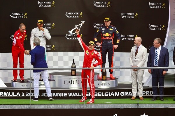 Sebastian Vettel, Ferrari celebrates with his trophy on the podium with (L to R): David Sanchez, Ferrari, Lewis Hamilton, Mercedes AMG F1, Max Verstappen, Red Bull Racing
