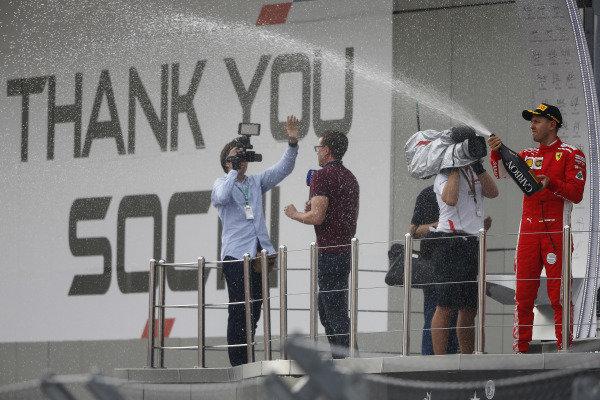 Sebastian Vettel, Ferrari, 3rd position, sprays Champagne from the podium