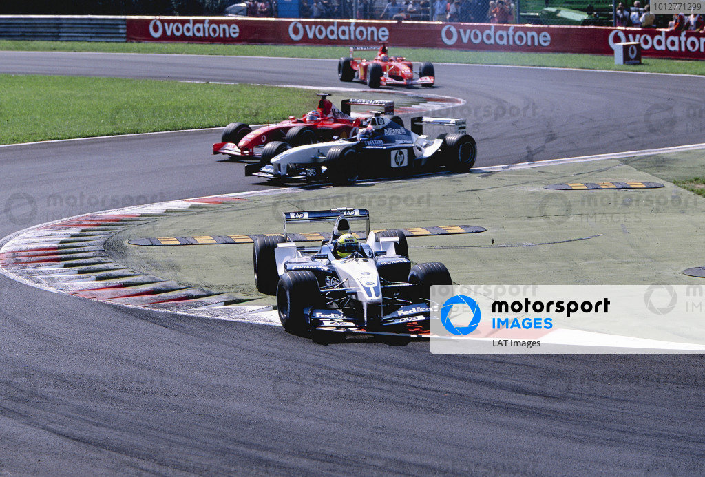 2002 Italian Grand PrixMonza, Italy. 14th - 16th September 2002Ralf Schumacher, BMW Williams FW24, cuts across the chicane, leading Juan-Pablo Montoya, Rubens Barrichello, Ferrari F2002, and Michael Schumacher, Ferrari F2002. World Copyright - LAT Photographicref: 35mm Transparency 02_ITA_04