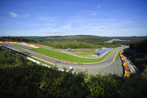 Sebastian Vettel, Ferrari SF90, leads Daniil Kvyat, Toro Rosso STR14