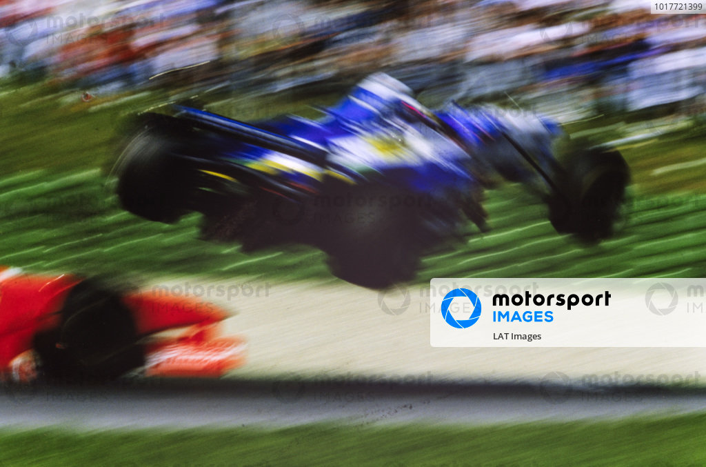 Jean Alesi, Benetton B197 Renault, flies through the air after a collision with Eddie Irvine, Ferrari F310B.