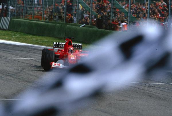 2002 San Marino Grand Prix. Imola, Italy. 12-14 April 2002. Michael Schumacher (Ferrari F2002) takes the chequered flag for 1st position. Ref-02 SM 30. World Copyright - LAT Photographic