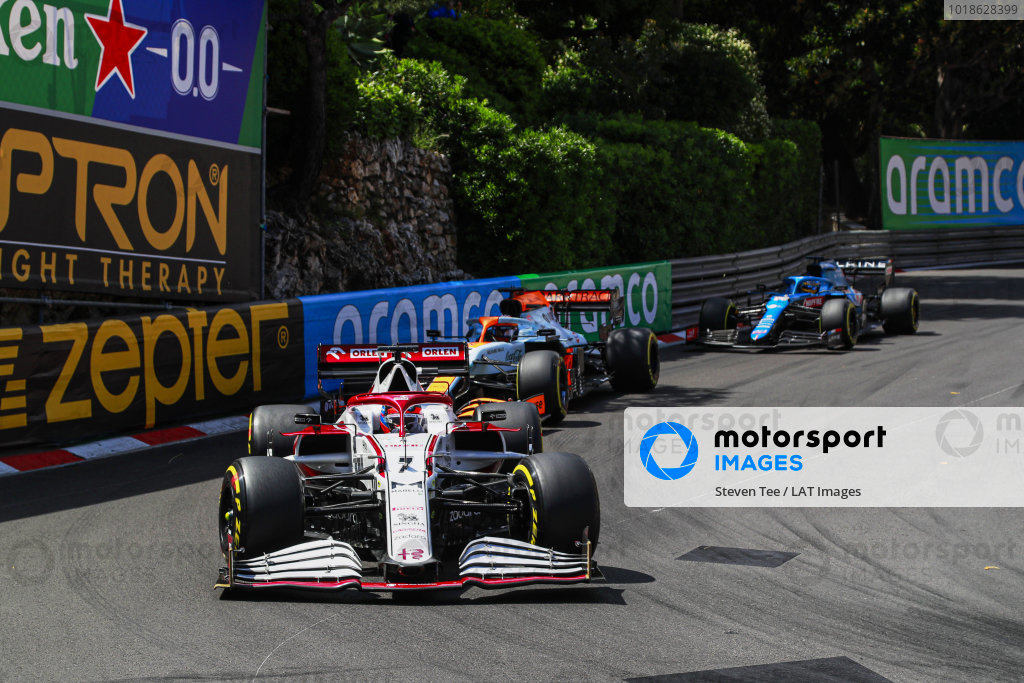 Kimi Raikkonen, Alfa Romeo Racing C41 , leads Daniel Ricciardo, McLaren MCL35M, and Fernando Alonso, Alpine A521