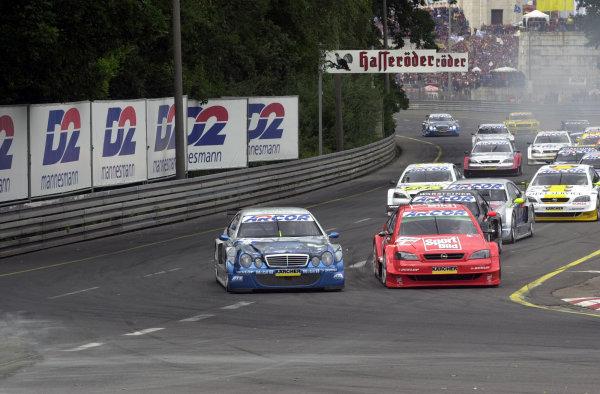 DTM Norisring 2000.Norisring, Germany. 7th - 9th July 2000.Marcel Tiemann and Joachim Winkelhock battle for the lead.World - Hardwick / LAT Photographic