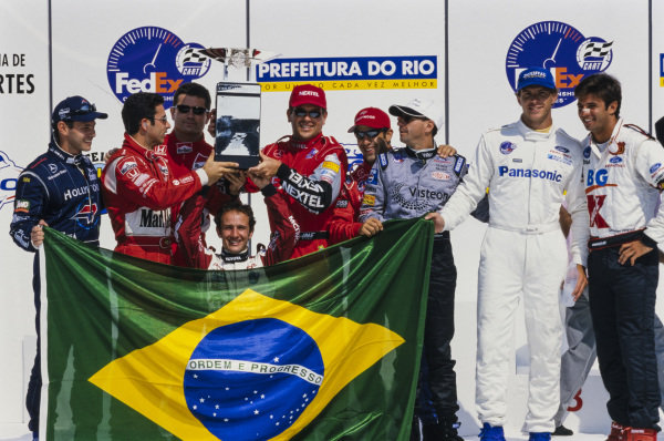 Brazilian drivers celebrate winning the previous year's Nation Cup. Left to right: Luiz Garcia Jr, Hélio Castroneves, Gil de Ferran, Cristiano da Matta, Maurício Gugelmin, Tony Kanaan, Roberto Moreno, Gualter Salles and Christian Fittipaldi.