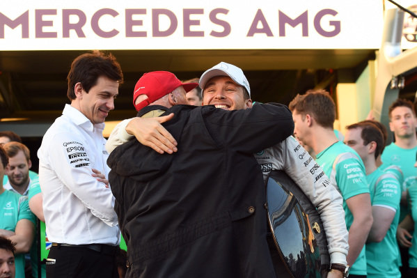 Toto Wolff (AUT) Mercedes AMG F1 Director of Motorsport and Niki Lauda (AUT) Mercedes AMG F1 Non-Executive Chairman celebrate with Nico Rosberg (GER) Mercedes AMG F1 during team celebrations at Formula One World Championship, Rd1, Australian Grand Prix, Race, Albert Park, Melbourne, Australia, Sunday 20 March 2016.