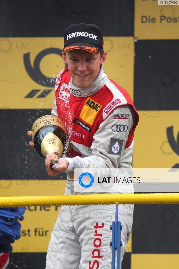 Race winner Mattias Ekstrom (SWE), Audi Sport Team Abt Sportsline, Red Bull Audi A4 DTM (2009) celebrates on the podium.DTM, Rd8, Oschersleben, Germany, 16-18 September 2011 Ref: Digital Image dne1118se559