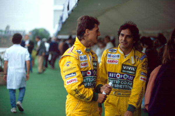 Barcelona, Spain. 27-29 September 1991.Michael Schumacher with team mate Nelson Piquet, in the paddock, portrait. Ref-91 ESP 30.World Copyright - LAT Photographic