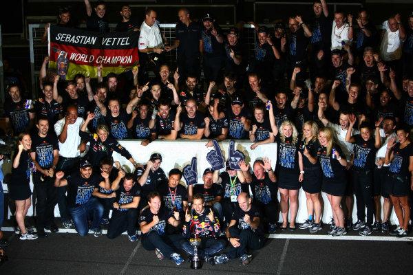 Suzuka Circuit, Suzuka, Japan.9th October 2011.Sebastian Vettel, Red Bull Racing RB7 Renault, 3rd position, celebrates his second world championship with his team. Portrait. Atmosphere. World Copyright: Andy Hone/LAT Photographicref: Digital Image CSP25945