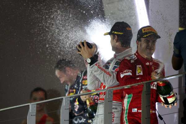 Marina Bay Circuit, Singapore23rd September 2012Jenson Button, McLaren, 2nd position, and Fernando Alonso, Ferrari, 3rd position, spray the Champagne.World Copyright: Andy Hone/LAT Photographicref: Digital Image HONY9524