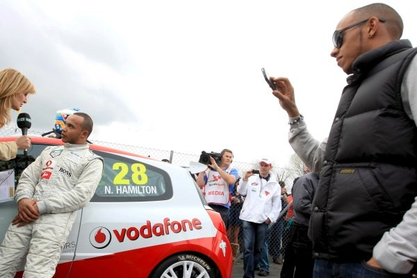 Nicolas Hamilton (GBR), Total Control Racing, is interviewed whilst brother Lewis Hamilton (GBR), McLaren, looks on. Renault Clio Cup, Rd1, Brands Hatch, England, 3 April 2011.