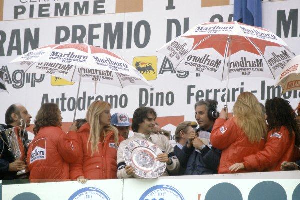 1981 San Marino Grand Prix.Imola, Italy. 1-3 May 1981.Nelson Piquet (Brabham BT49C-Ford Cosworth), 1st position, on the podium.World Copyright: LAT PhotographicRef: 35mm transparency 81SM05