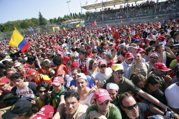 2006 San Marino Grand Prix - Sunday Race Imola, Italy. 20th - 23rd April 2006 Ferrari fans invade the track, tifosi, atmosphere. World Copyright: Lorenzo Bellanca/LAT Photographic ref: Digital Image ZD2J7969