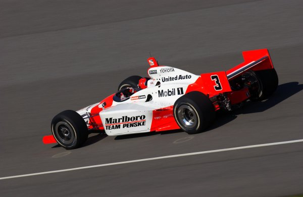 Indy Racing Leauge IndyCar Series Firestone Indy 400, Michigan International Speedway, Brooklyn, Michigan, USA 25 July, 2003Helio Castroneves drives into turn one.World Copyright-F Peirce Williams 2003 LAT Photographicref: Digital Image Only
