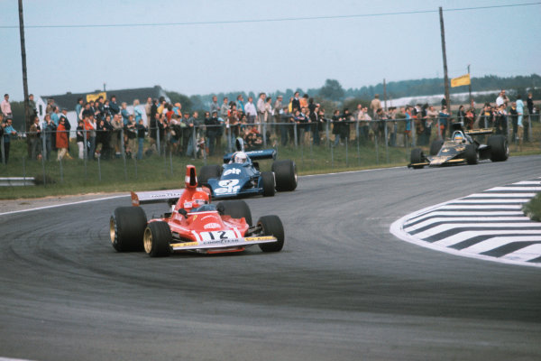 1974 Belgian Grand Prix  Nivelles-Baulers, Belgium. 10-12th May 1974.  Niki Lauda, Ferrari 312B3, leads Jody Scheckter, Tyrrell 007 Ford, and Ronnie Peterson, Lotus 76 Ford.  Ref: 74BEL03. World Copyright: LAT Photographic