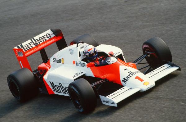 1986 Italian Grand Prix. Monza, Italy. 5th - 7th September 1986. Alain Prost (McLaren MP4/2C-TAG Porsche), retired, action.  World Copyright: LAT Photographic. Ref:  86 ITA 04.