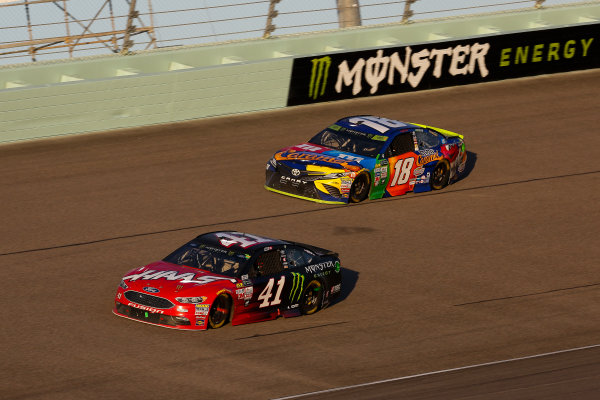 Monster Energy NASCAR Cup Series Ford EcoBoost 400 Homestead-Miami Speedway, Homestead, FL USA Sunday 19 November 2017 Kurt Busch, Stewart-Haas Racing, Haas Automation/Monster Energy Ford Fusion and Kyle Busch, Joe Gibbs Racing, M&M's Caramel Toyota Camry, Monster Energy sign World Copyright: Barry Cantrell LAT Images