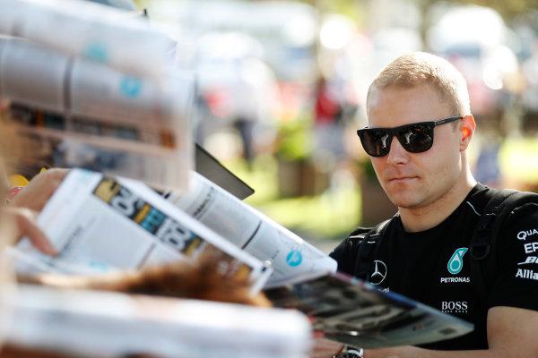 Albert Park, Melbourne, Australia. Wednesday 22 March 2017. Valtteri Bottas, Mercedes F1 W08 EQ Power+, signs autographs for fans. World Copyright: Sam Bloxham/LAT Images ref: Digital Image _J6I0336