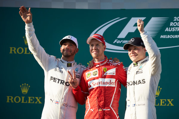 Albert Park, Melbourne, Australia. Sunday 26 March 2017. Lewis Hamilton, Mercedes AMG, 2nd Position, Sebastian Vettel, Ferrari, 1st Position, and Valtteri Bottas, Mercedes AMG, 3rd Position, on the podium. World Copyright: Steve Etherington/LAT Images ref: Digital Image SNE25432