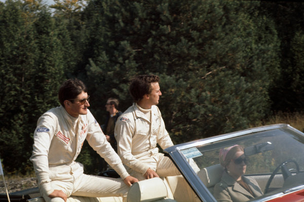 1969 Canadian Grand Prix.  Mosport, Canada. 18-20th September 1969.  John Miles and Jackie Oliver in the drivers parade.  Ref: 69CAN05. World Copyright: LAT Photographic
