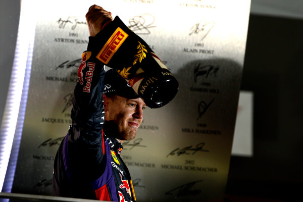 Marina Bay Circuit, Singapore. Sunday 22nd September 2013.  Sebastian Vettel, Red Bull Racing, celebrates on the podium.  World Copyright: Glenn Dunbar/LAT Photographic. ref: Digital Image _89P1492