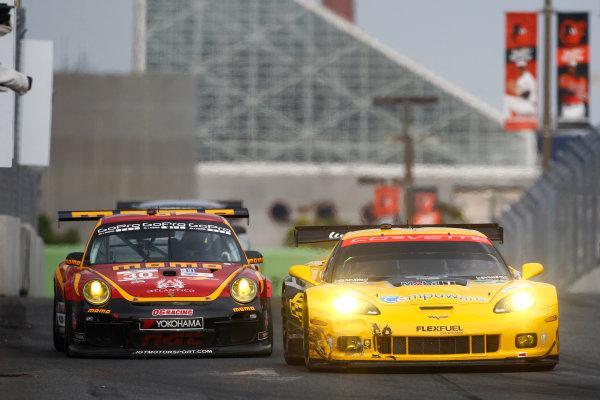 30-31 August, 2013, Baltimore, Maryland USA Jan Magnussen/Antonio Garcia Corvette leads Henrique Cisneros/Sean Edwards Porsche ©2013, Phillip Abbott LAT Photo USA
