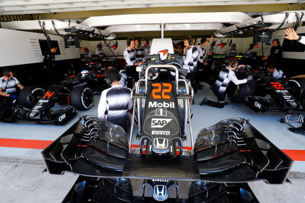 Interlagos, Sao Paulo, Brazil. Friday 11 November 2016. A nose cone in front of the McLaren garage. Jenson Button and Fernando Alonso wait in their McLaren MP4-31 Honda cars. World Copyright: Steven Tee/LAT Photographic ref: Digital Image _O3I7956