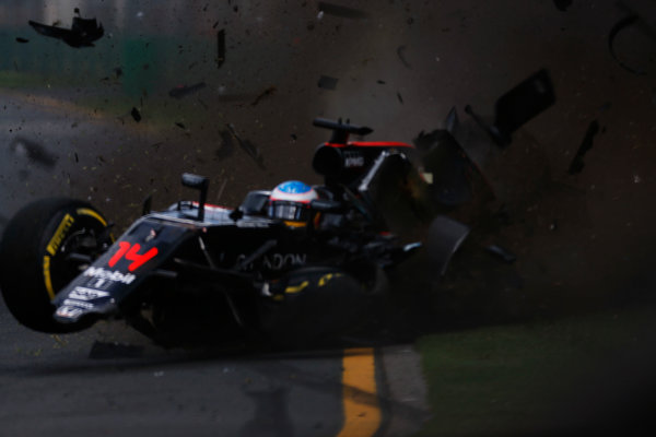 Albert Park, Melbourne, Australia. Sunday 20 March 2016. Fernando Alonso, McLaren MP4-31 Honda, ploughs in to the barriers after colliding with Esteban Gutierrez, Haas VF-16. World Copyright: Sam Bloxham/LAT Photographic ref: Digital Image _R6T3645