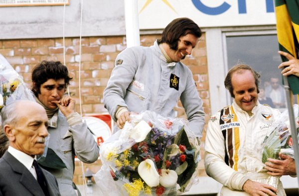 The podium (L to R): Francois Cevert (FRA) Tyrrell second place; Emerson Fittipaldi (BRA) Lotus race winner; Denny Hulme (NZL) McLaren third. Belgian Grand Prix, Circuit de Nivelles-Baulers, 4 June 1972. BEST IMAGE