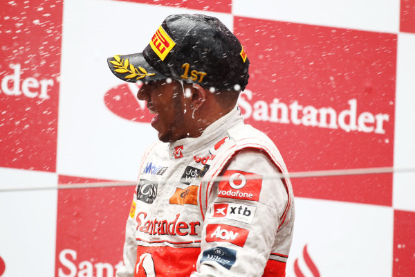 Race winner Lewis Hamilton (GBR) McLaren on the podium.  Formula One World Championship, Rd 10, German Grand Prix, Race, Nurburgring, Germany, Sunday 24 July 2011.