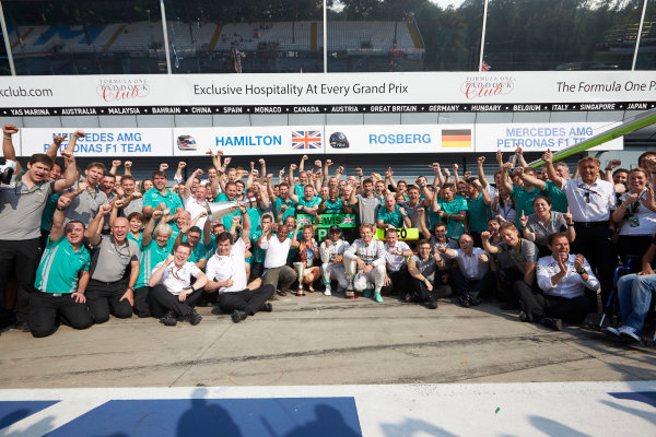 Autodromo Nazionale di Monza, Monza, Italy. Sunday 7 September 2014. The Mercedes team celebrate another 1-2 victory. World Copyright: Steve Etherington/LAT Photographic. ref: Digital Image SNE28627