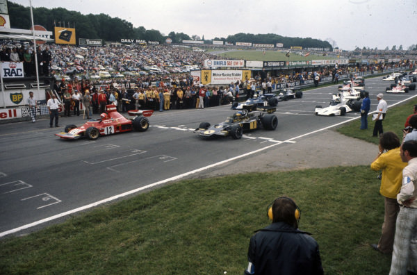 Niki Lauda, Ferrari 312B3 leads Ronnie Peterson, Lotus 72E Ford and Jody Scheckter, Tyrrell 007 Ford away from pole position on the formation lap.