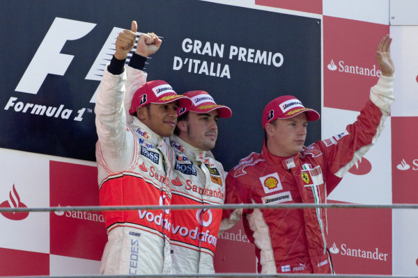Podium group photo: Lewis Hamilton, 2nd position, winner Fernando Alonso, and Kimi Raikkonen, 3rd position.