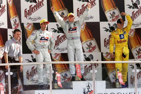 2001 German DTM ChampionshipEurospeedway, Lausitz. Germany. 12th August 2001.Race podium, Peter Dumbreck, 1st, Bernd Schneider, 2nd, (both AMG Mercedes-Benz CLK), Mattias Ekstrom, 3rd, (Abt-Audi TT-R).World Copyright: Iler/ASA/LAT Photographic.Digital Image Only