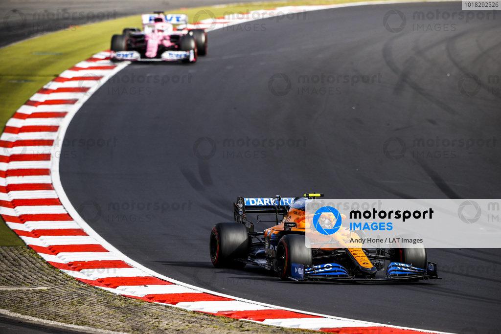 Lando Norris, McLaren MCL35, leads Sergio Perez, Racing Point RP20