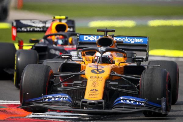 Carlos Sainz Jr., McLaren MCL34 and Alexander Albon, Red Bull RB15