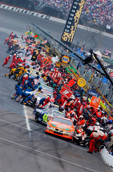 2002 NASCAR Atlanta Motor Speedway, October 25, 2002 NAPA 500/Aaron 's 312A filled pit road prior to the rain delay,-Robt LeSieur2002LAT Photographic