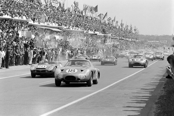 Phil Hill / Lucien Bianchi, David Brown Corporation, Aston Martin DP215, leads Roger Penske / Pedro Rodriguez, North American Racing Team, Ferrari 330LM, Innes Ireland / Bruce McLaren, David Brown Corporation, Aston Martin DP214, and Willy Mairesse / John Surtees, Scuderia Ferrari, Ferrari 250P, at the start of the race.