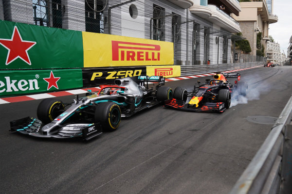Max Verstappen, Red Bull Racing RB15 Honda, makes contact with leader Lewis Hamilton, Mercedes AMG F1 W10, in the closing stages of the race into the Nouvelle Chicane.